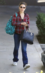 Mila Kunis had her hands full with a printed backpack and a Dior tote.