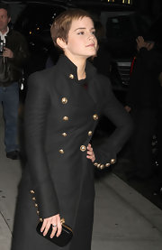 Emma Watson teamed a black Alexander McQueen Punk Skull clutch with a gold-buttoned black coat for an edgy-glam look during her visit to 'Letterman.'