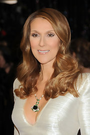 Celine Dion looked glam with her long side-parted curls at the 2011 Oscars.