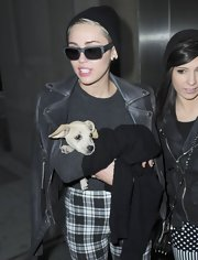 Miley Cyrus kept a low profile with a pair of rectangular shades while leaving a photo studio in New York.