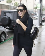 Kim Kardashian styled her workout attire with a luxurious black Chanel backpack.