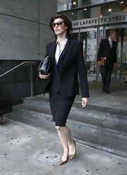 Linda Evangelista walked out of the courtroom wearing a black skirt suit.