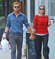 Ryan Gosling confidently held hands with Eva Mendes while wearing a vintage inspired blue button-down shirt.