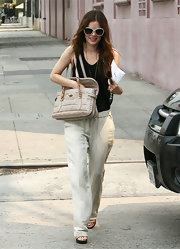 Rachel Bilson showed off her breezy-chic street style with these beige linen pants teamed with a black tank top.