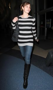 A pair of black knee-high boots pulled Jessica Biel's stylish airport look together.