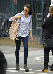 Michelle Keegan styled her casual outfit with a fringed nude suede bag.