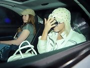 Lady Gaga hid her face from paparazzi with her black-manicured fingers while out in London.