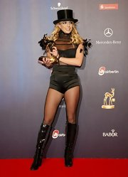 Britney Spears wears a top hat with her black bodysuit for the Bambi Awards.