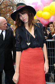 Lou Doillon styled her outfit with a wing pendant necklace when she attended the Chanel fashion show.