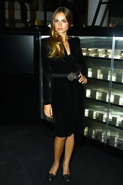 Kasia Smutniak paired her dress with rosette-embellished black peep-toes.