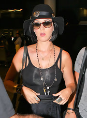 Katy Perry sported a cute pair of plaid wayfarers by Ray-Ban.