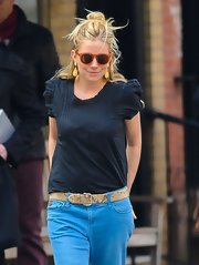 Sienna Miller wore a snakeskin belt for a chicer finish to her jeans.