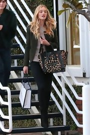 Rosie Huntington-Whiteley went shopping at Fred Segal rocking a leopard-print Celine Luggage tote.