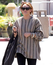 Miley Cyrus paired a geometric-patterned bangle with a striped sweater for a day out in LA.