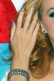 Katy Perry dolled up her lobes with a pair of blue gemstone studs by Lorraine Schwartz.