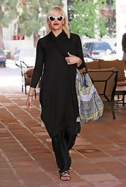 Gwen Stefani teamed an oversized black shawl-collar cardigan with a pair of harem pants for a day of shopping in Malibu.