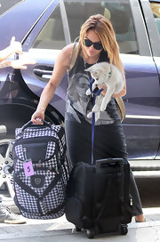 Miley Cyrus completed her travel ensemble with a black rollerboard.