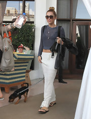 For her footwear, Miley Cyrus went ultra comfy with a pair of black flip flops.