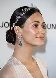 Emmy Rossum looked exotic with her center-parted braided bun during Elton John's Oscar viewing party.