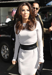 Eva Longoria jazzed up her sweater dress with an oversized black belt with tassel detail for a day out in New York City.