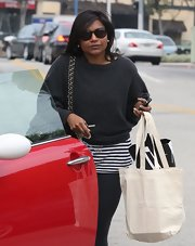 Mindy Kaling stepped out for a day of shopping wearing a pair of round shades.