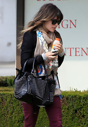 Rachel Bilson softened her edgy look with a colorful floral scarf while visiting a salon.