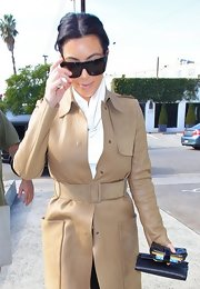Kim Kardashian showed off her tiny waist with a stylish nude suede belt while out and about in West Hollywood.