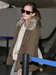 Emma Watson flew into LAX wearing classic Ray-Ban wayfarers.