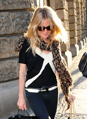 Sienna Miller wore a black-and-white leather belt that echoed the style of her top.