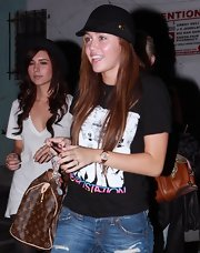 Miley Cyrus stepped out in Santa Monica wearing a cute black cloche by Gucci.