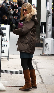 Jennifer Aniston kept her feet comfy in flat suede boots by Bronx.