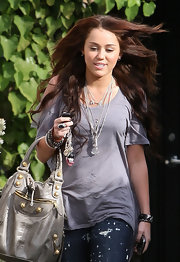Miley Cyrus styled a simple gray tee with layers of sterling necklaces for a day out in LA.
