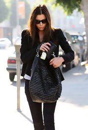 Jessica Biel made an edgy fashion statement with this Jimmy Choo studded hobo bag and moto jacket combo while out in West Hollywood.