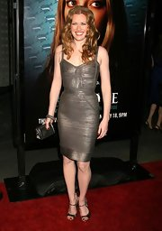 Mireille Enos pulled off a metallic-themed outfit -- a bandage dress, peep-toe pumps, and a quilted purse -- at a TV series premiere.