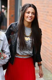 Michelle Keegan topped off her ensemble with a gold statement necklace.