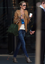 Rosie Huntington-Whiteley looked edgy-cool on the streets of Sydney in a tan leather jacket by Isabel Marant.