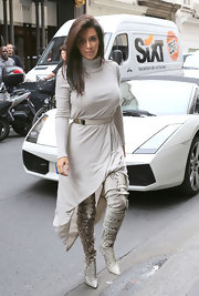 Kim Kardashian covered up in a pale-gray Doo.Ri turtleneck dress for a stroll in Paris.