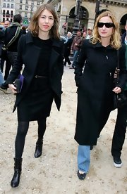 Sofia Coppola pulled her cold-weather ensemble together with a pair of black mid-calf boots.