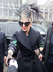 Lady Gaga brought her flamboyant style to Harvard with this artsy headpiece.