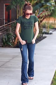 Miley Cyrus dressed down in a green Free City tee for a day out.