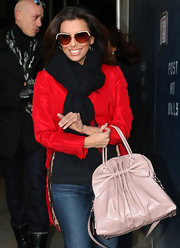 Eva Longoria hid her eyes behind a pair of Robert Verdi sunnies as she left the Knicks game.