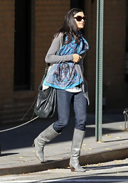 Famke Janssen walked her dog in the meat packing district of NYC carrying a leather tasseled shoulder bag.