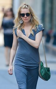 Sienna Miller accessorized with a green python-print chain-strap bag by Stella McCartney for a sophisticated finish to her casual dress.