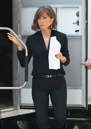 Jennifer Aniston looked effortlessly stylish in a long-sleeve V-neck blouse and slacks on the set of 'Squirrels to the Nuts.'
