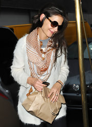 Katie Holmes jazzed up her sweater with a patterned scarf for a day out in New York City.