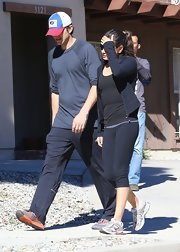 Mila Kunis completed her outfit with a pair of black capri leggings by The Girls Apparel.