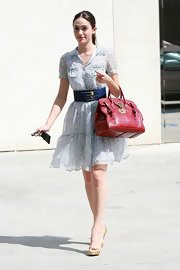 Emmy Rossum's red crocodile tote added major elegance to her casual day look.