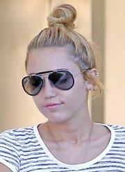Miley Cyrus wore her hair in a casual top knot for a day of errands.
