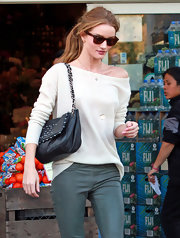 A black leather shoulder bag by Chanel added a luxurious touch to Rosie Huntington-Whiteley's shopping outfit.