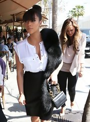 Kim Kardashian doesn't need a red carpet event to get all glammed up with a black fur stole.